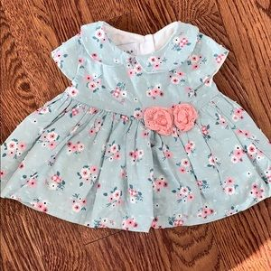 Short sleeve floral infant dress.
